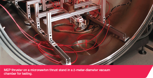 MEP thruster on a micronewton thrust stand in a 2-meter-diameter vacuum chamber for testing.
