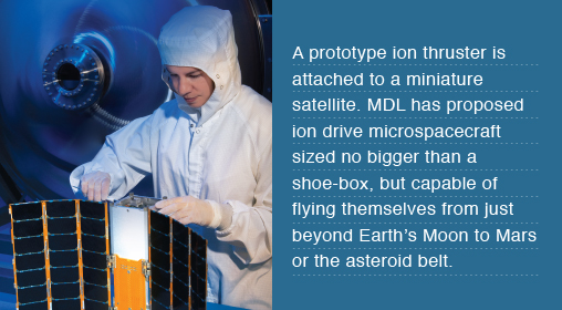 A prototype ion thruster is attached to a miniature satellite. MDL has proposed ion drive microspacecraft sized no bigger than a shoe-box, but capable of flying themselves from just beyond Earth's Moon to Mars or the asteroid belt.